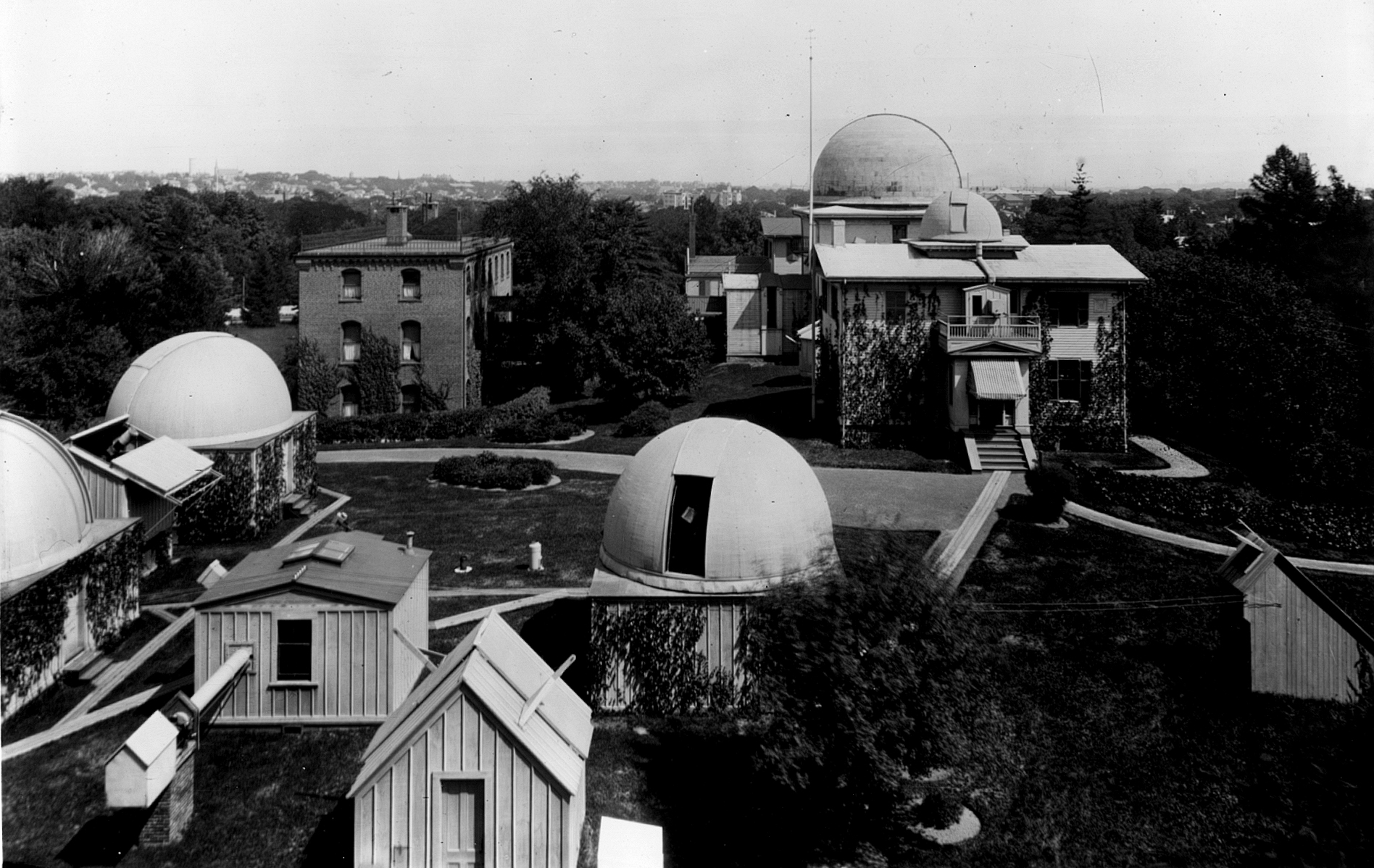 Grounds of Harvard College Observatory, circa 1899. (Source: Harvard College Observatory. This media file is in the public domain because its copyright has expired).