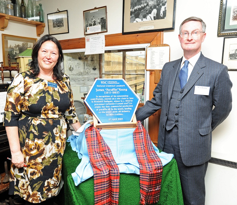 Professor Lesley Yellowless and Ian Blackley with the plaque commemorating James 'Paraffin' Young