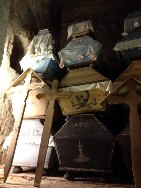 Stacked decorated coffins of the Vác mummies. By Carole Reeves.