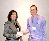 Winner Michal Meyer (left) receives the prize from BSHS Website Editor James Sumner