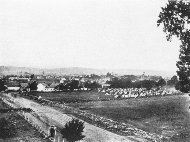 Black and white photograph of Town of Gettysburg, Pennsylvania, about the time of the Civil War battle. The point of view is about where the Eleventh Corps was positioned.