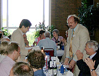 2005 Slade Prize winner Hasok Chang (standing, left) receives the award from the BSHS President, Frank James, at the 2006 Annual Conference