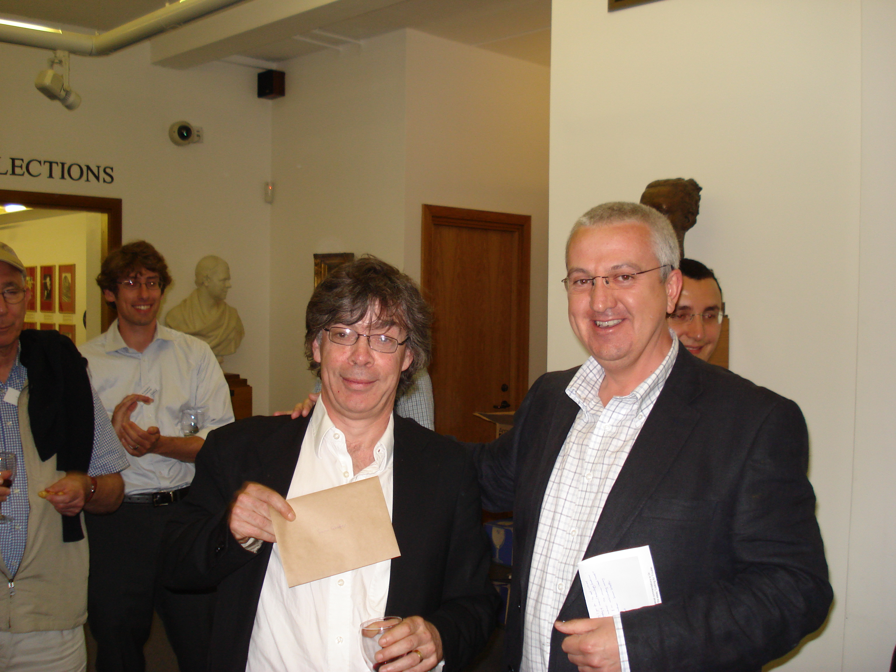 2009 Slade Prize winner Prof. Simon Schaffer (left) receives the award from the BSHS Vice-President, Jeff Hughes. Photo credit - James Sumner