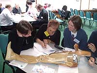 Participants contemplate ventriloquising an artificial leg at the 2007 Annual Conference